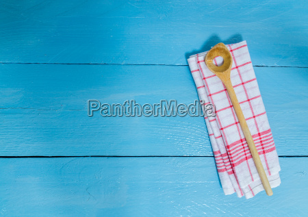 cooking spoon and tea towel on