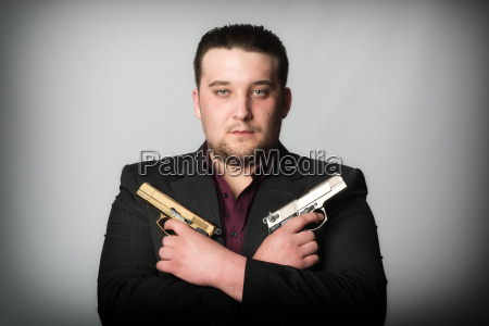agent holding two guns