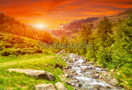 colorful sunset and a river in