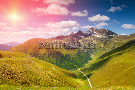 colorful alpine scenery with sun setting