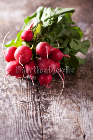 close up of red radishes wood