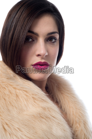 stylish young woman in fur coat