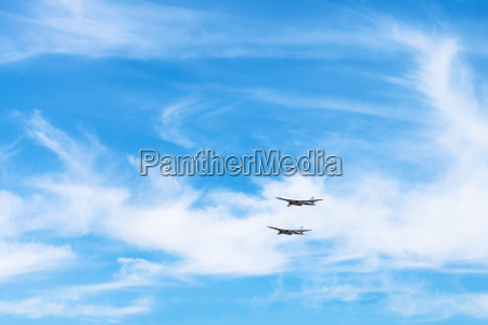 two strategic bomber aircrafts in white