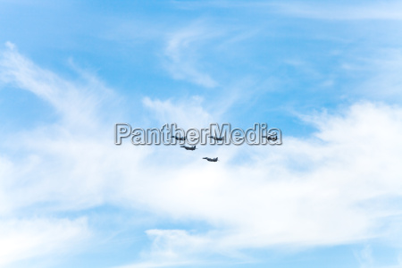 flight of military fighter planes in