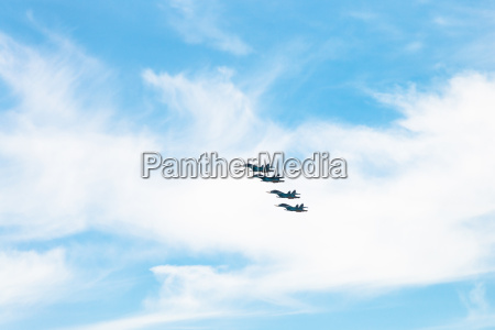 four military fighter airplanes in white