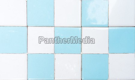 white and blue restroom tile wall