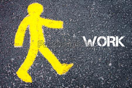 yellow pedestrian figure walking towards work