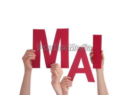 people holding german word mai means