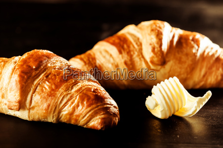 butter and croissant bread on top