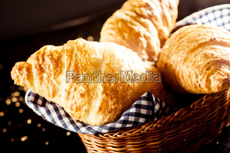 gourmet delicious croissant on bread basket