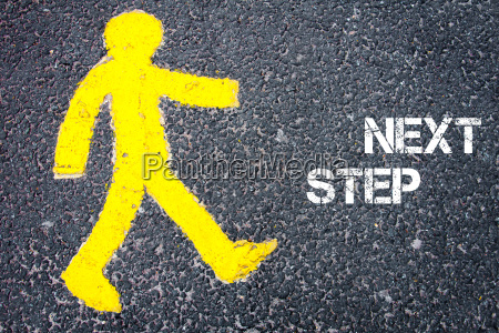 yellow pedestrian figure walking towards next