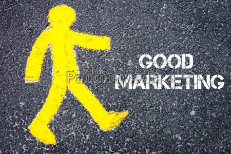yellow pedestrian figure walking towards good