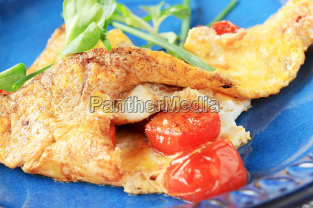egg omelet with tomatoes and salad