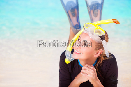 happy tourist girl snorkeling