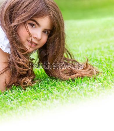 little girl on the grass