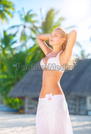 woman tanning on the beach