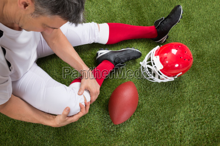 american football player with injury in