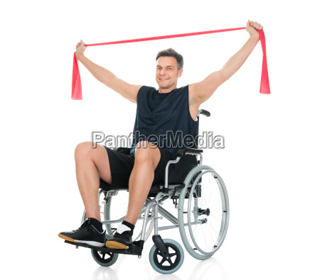 disabled man on wheelchair exercising with