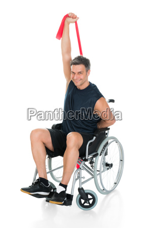 disabled man on wheelchair stretching with