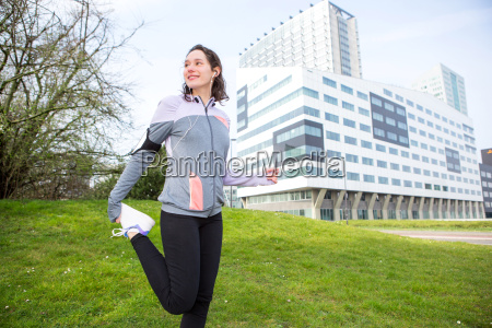 young attractive woman stretching after a