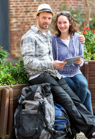 couple of attractive tourists using tablet