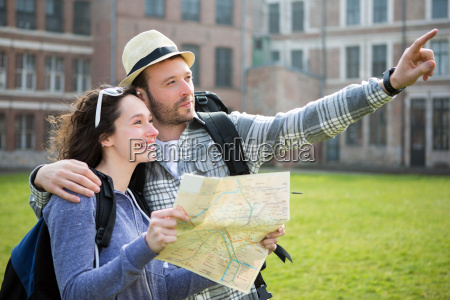 couple, of, young, attractive, tourists, watching - 14176221