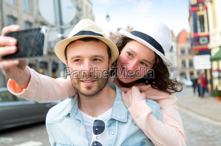 young, couple, on, holidays, taking, selfie - 14176317