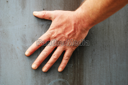 male hand against grey background