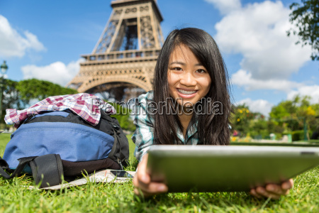 young attractive asian tourist using tablet