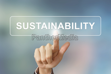 business hand clicking sustainability button on