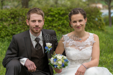 newlyweds with wedding bouquet in the