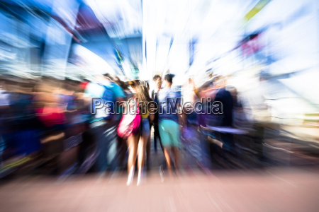 people climb a ferry motion blur