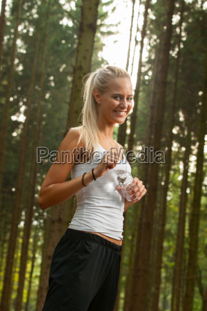 young jogger with a water bottle