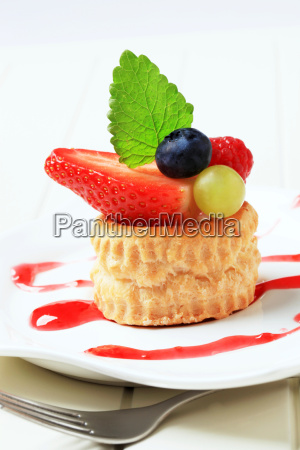 custard filled puff pastry shell topped