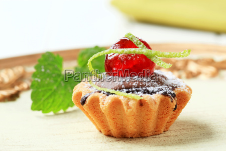 chocolate filled tartlet topped with maraschino