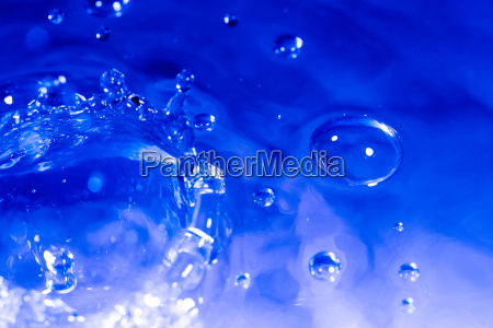 background of blue water drops splash