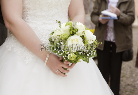 bride with bridal bouquet in hand