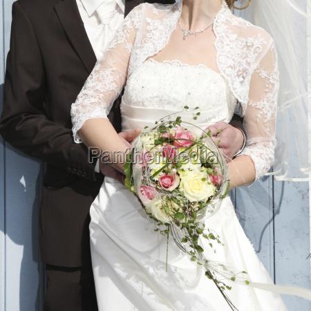 bride is held by groom