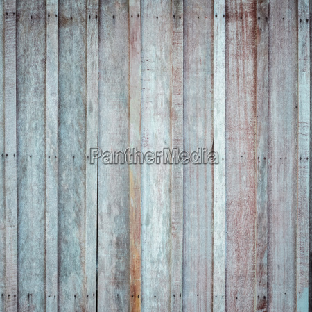 wooden wall with the hammered rusty