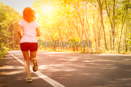 young women running on rural road