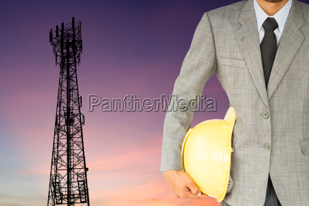 businessman engineer and telecommunication tower at