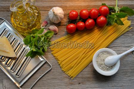 pasta tomato parmesan on wood background