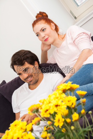 young couple sitting in living room
