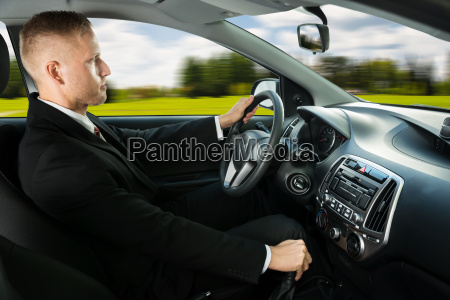 male driving a car