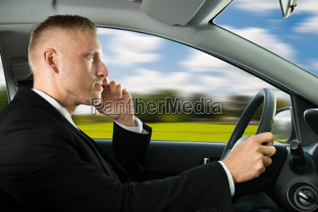 man using cellphone while driving