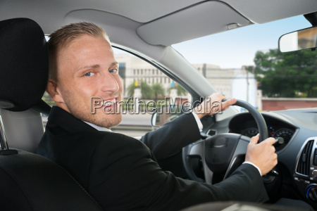 happy businessman in his car
