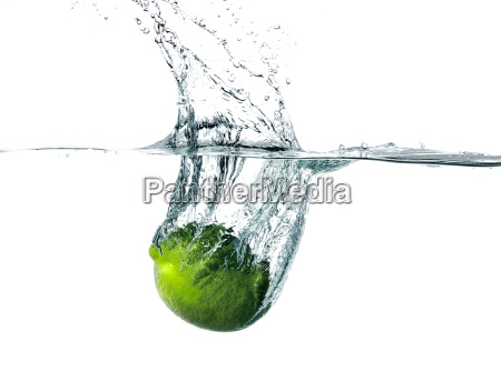 fresh lime falling into water