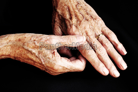 the aching hands of an old