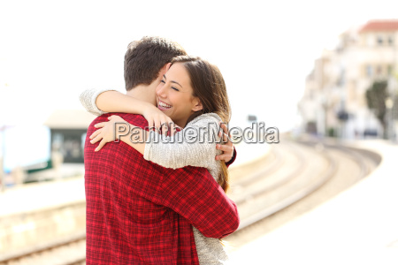 couple hugging happy in a train