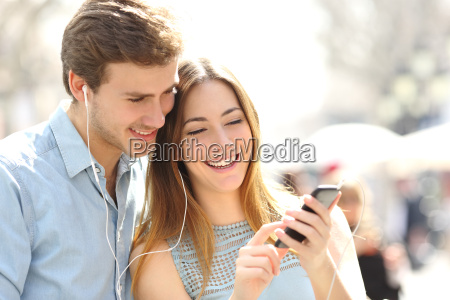 couple sharing music from a smart